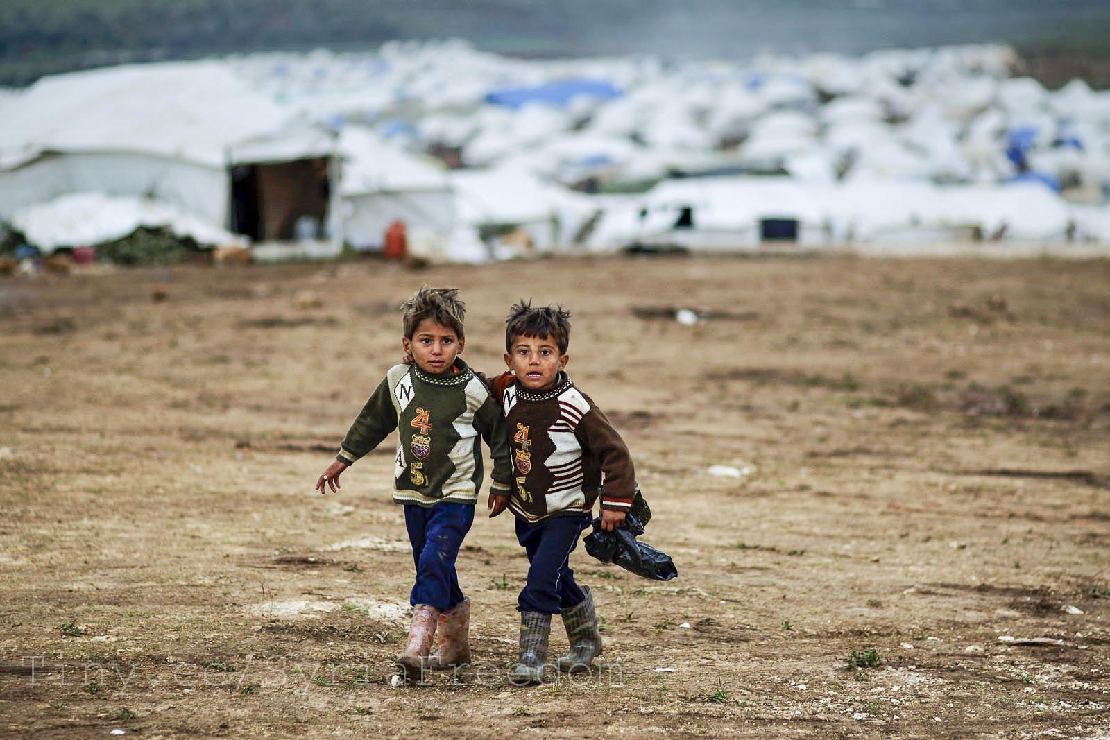 Syrische vluchtkinderen in hun kamp in Atmeh, 2012