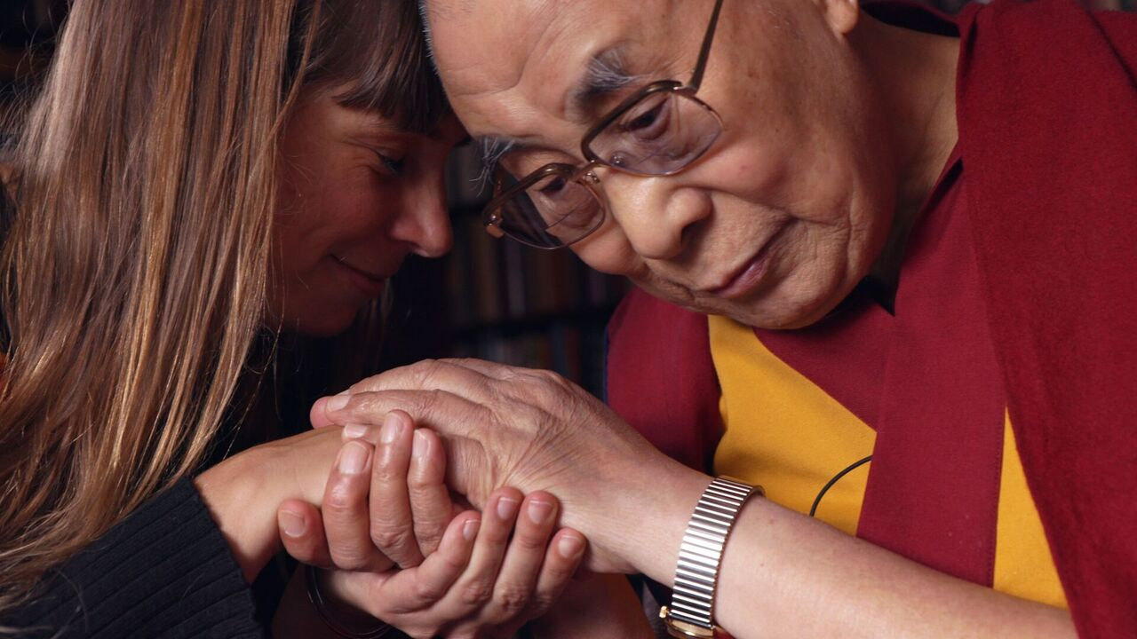 His Holiness The Dalai Lama with Dr. Eve Ekman with The Atlas of Emotions - photo credit Lemle Pictures